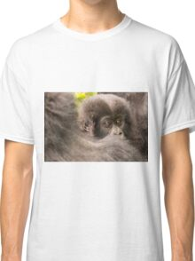 Baby gorilla looks over shoulder of mother Classic T-Shirt