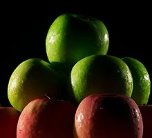 Apples red and green with low key lighting. by Rob D
