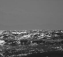 Evening sun on sea at Newborough Beach by velocitypink