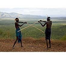 YOUNG MURSI MEN STICK FIGHTING Photographic Print
