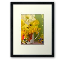 A Cup Of Golden Daffodils Framed Print