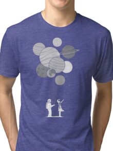 Between planets and balloons. Tri-blend T-Shirt