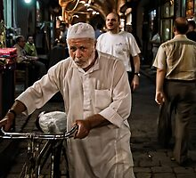 A man and his bycicle by PhotosOnTheRoad