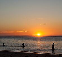 swimming at sunset on the beach of Flic en Flac,Mauritius. by rajeshbac