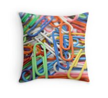 a cluster of paper clips Throw Pillow