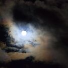 Clouds racing over the super moon in western Montana by amontanaview