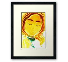 Mary all aglow Framed Print