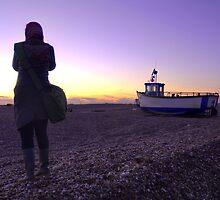 Woman standing on a beech by jimclark