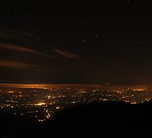 Mid Kerry at night from Purple Mt by amuigh-anseo