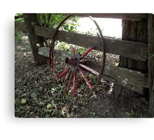 Old fence and wheel. Pyree. Canvas Print