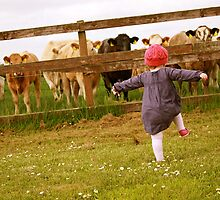 toddler chasing the cows by heatherbyrne