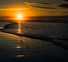Setting Sun, Bamburgh, Northumberland Coast. UK by David Lewins