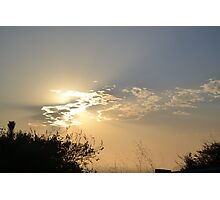 Sunset behind clouds Photographic Print