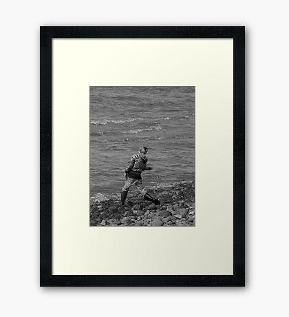 Boy Skipping Rocks Framed Print