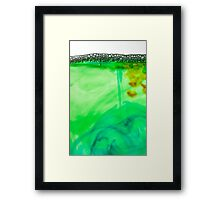Bubbles on coloured water Framed Print