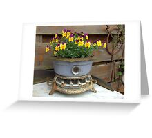 Violets in an old oil stove. Greeting Card