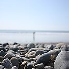 Pebbles on the beach by Joanne Plimmer