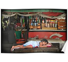 Child sleeping on shop table, Thailand Poster