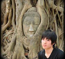 Young man and buddah  at Wat Mahathat, Thailand by Catherine Ames