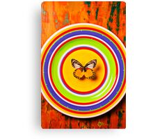 Butterfly On Plate Canvas Print