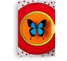 Blue Butterfly On Red Plate Canvas Print