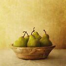 Pears in a wooden bowl by Priska Wettstein