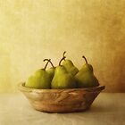 Pears in a wooden bowl by Priska Wettstein