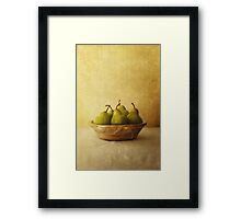 Pears in a wooden bowl Framed Print