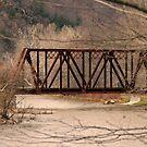 Railroad Bridge Over Swollen Oil Creek by Geno Rugh