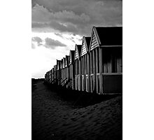 Might need to shelter (B&W beach huts) Photographic Print