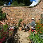 Fat man on a bench contemplates The Meaning of Life by nigelphoto