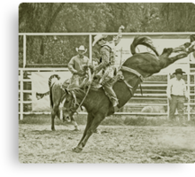 Cowboy Rides a High Kicking Bronco Canvas Print