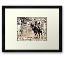 A Rodeo Cowboy Rides his Bull Framed Print