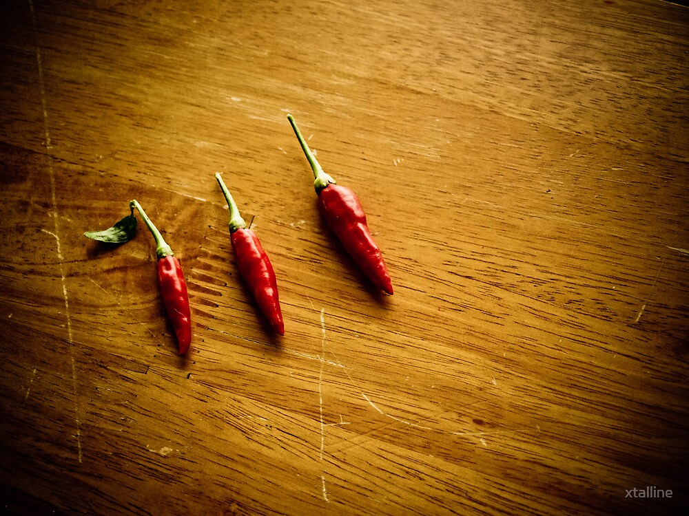 Three red chilies all in a row by xtalline