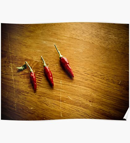 Three red chilies all in a row Poster