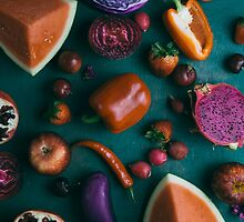 Red food on dark green by Alita  Ong