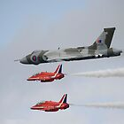 Vulcan XH558 with the Red Arrows by Peter Talbot