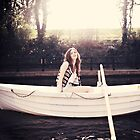 Girl in a boat  by Daniyel Lowden