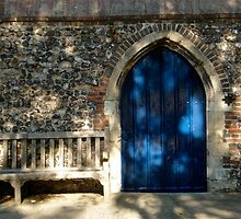 Blue door in shadow by richard  webb