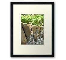 water flowing over falls surrounded by gigantic trees Framed Print