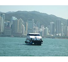 Ferry coming in to dock in Hong Kong Harbour on sunny day Photographic Print
