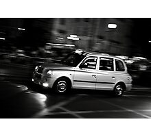Taxi speeding up Photographic Print