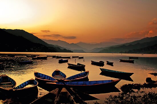Empty boats at sunset by Om Yadav