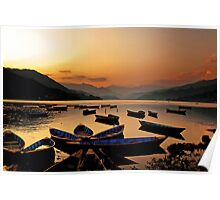 Empty boats at sunset Poster