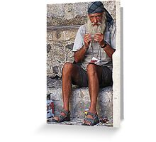 man just sitting and watching Greeting Card