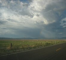 Clouds, Rainbow over Carson Valley, NV by Maurine Huang