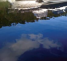 Boat Reflections by Caine Mazoudier
