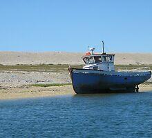 Boat at Chesil Beach, Dorset by moyrab