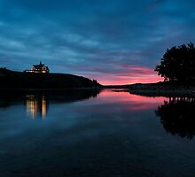 Sunrise over Waterton Lakes National Park and The Prince of Wales Hotel. by Alex Preiss
