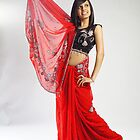 Indian girl in red sari by Dutchessphotos